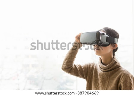 Woman using the virtual reality headset in office