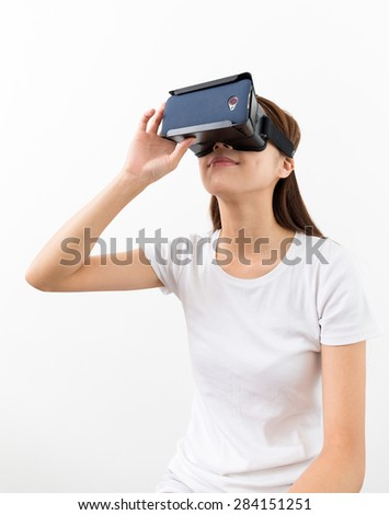 Woman using the VR device and look up - stock photo