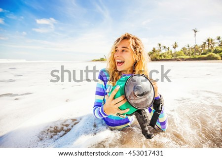 woman using underwater camera in waves - stock photo