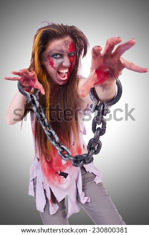 Woman vampire isolated on the background - stock photo