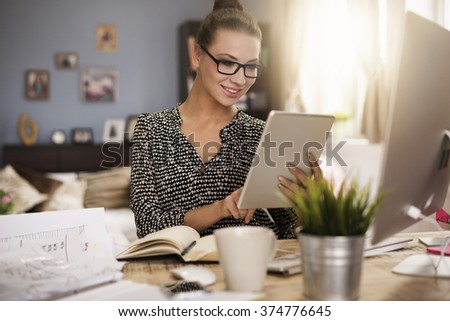 Woman very satisfied with her work - stock photo