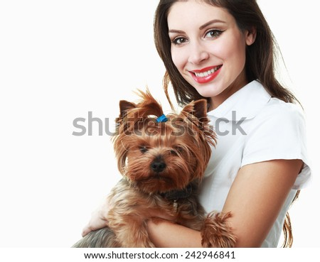 woman veterinarian holding a puppy - Yorkshire Terrier  - stock photo