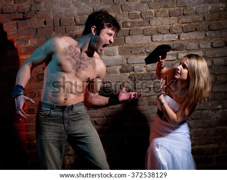 Woman victim of domestic violence. Aggression in the family.Family fights.Family hatred.Heavy men and women. - stock photo