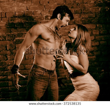 Woman victim of domestic violence. Aggression in the family.Family fights.Family hatred.Heavy men and women.Sepia color. - stock photo