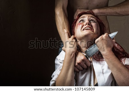 Woman victim of domestic violence and abuse - stock photo