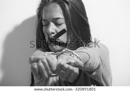 Woman victim of domestic violence and abuse,black and white photo.