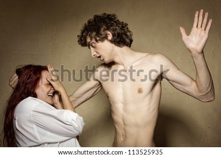 Woman victim of domestic violence and abuse. Husband beats his wife - stock photo