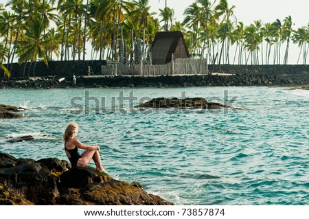 Woman viewing Place of Refuge National Park on the island of Hawai'i - stock photo