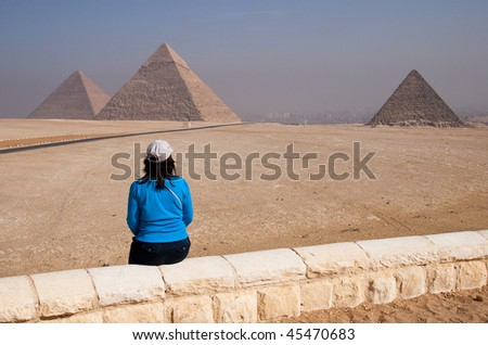 Woman Viewing the Egyptian Pyramids of Giza - stock photo