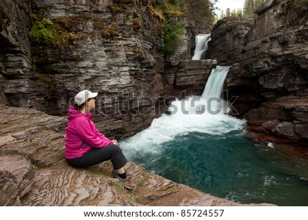Woman Viewing Waterfall (St. Mary Falls, Glacier National Park) - stock photo