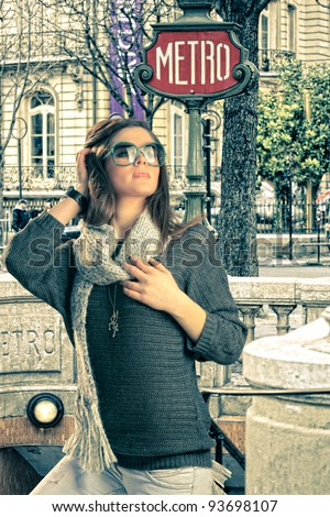 Woman visiting Paris in France out of the Metro station - stock photo