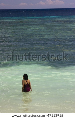 woman wading in shore