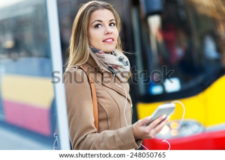 Woman Waiting at Bus Stop - stock photo