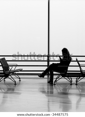 Woman waiting at the airport - stock photo