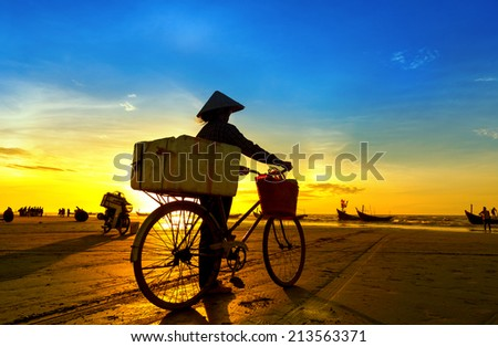 Woman waiting for her husband to return sea fishing - stock photo