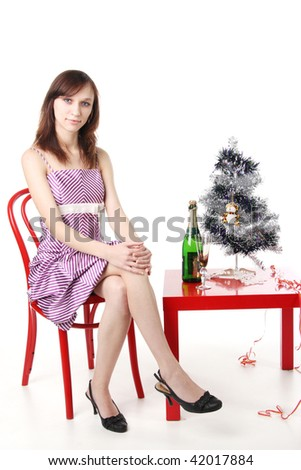 woman waiting for the New Year with champagne