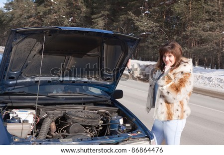 Woman waiting support near  her broken car - stock photo