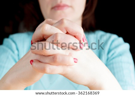 woman waiting with fingers crossed - stock photo