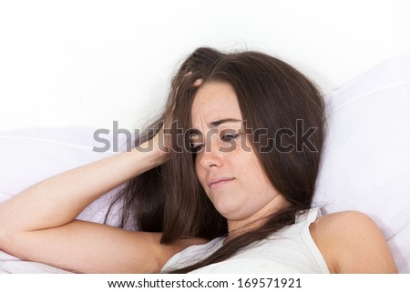 woman wakes up with a sore head - stock photo