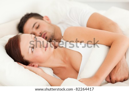 Woman waking for the sound of snores in the bedroom