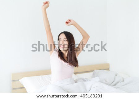 Woman waking up at morning