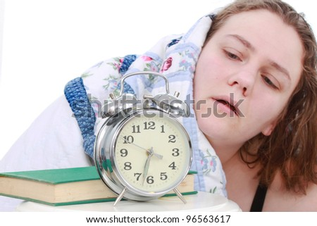 Woman waking up to alarm clock - stock photo