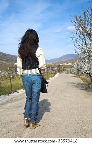 woman walking at valley of jerte in caceres spain