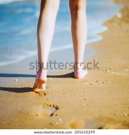 stock photo woman walking barefoot on sunny beach in summer day photo with instagram style filters 205610299 Dating Sites International