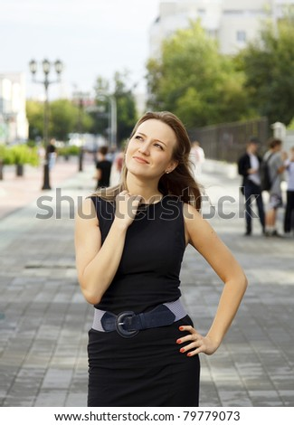 Woman walking down the street - stock photo