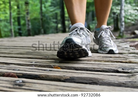 Woman walking in forest, exercising outdoors - stock photo