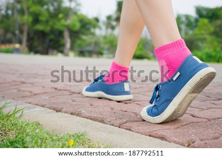 Woman walking in status section, exercising outdoors - stock photo