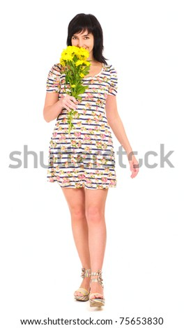 Woman walking in summer dress with yellow flowers isolated on white - stock photo