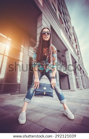 woman walking in the city - stock photo