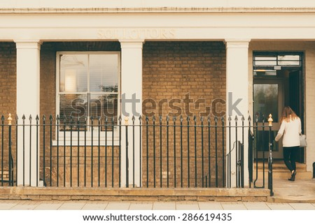 Woman walking into a Solicitors office closeup - stock photo
