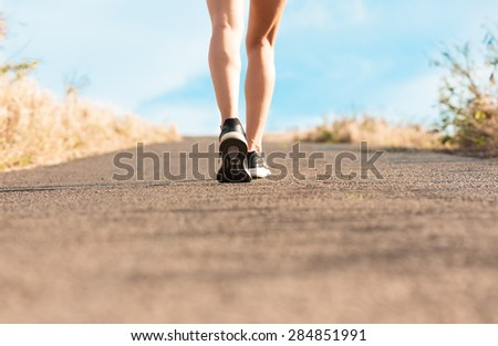 Woman walking on a path. (Fitness concept)  - stock photo