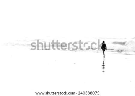 woman walking on beach. High key photo - stock photo