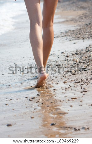 stock photo woman walking on the sand beach 189469229 » Your World With an International Star of the event Agency