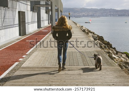 woman walking the dog - stock photo