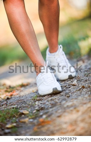 Woman walking trail - stock photo