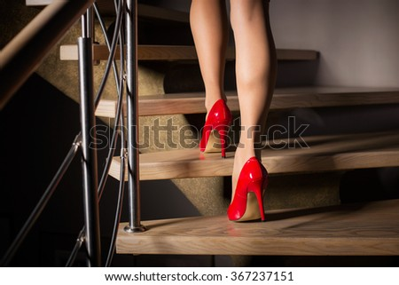 Woman walking up stairs  - stock photo