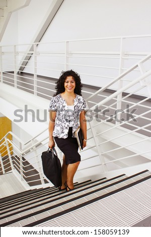 Woman walking up the stairs - stock photo