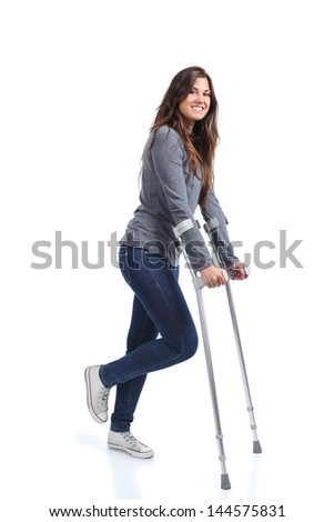Woman walking with crutches on a white isolated background - stock photo