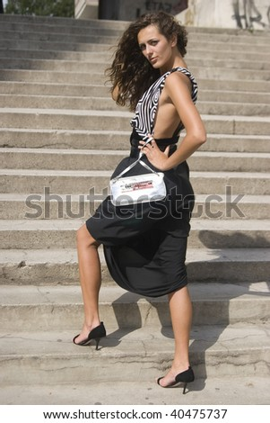 Woman walking with hand bag