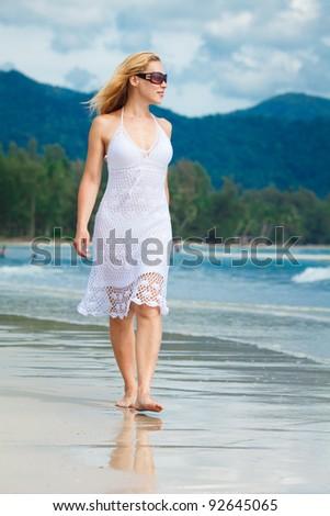 woman walks on a beach - stock photo