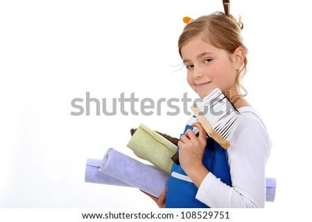 Woman wallpapering - stock photo