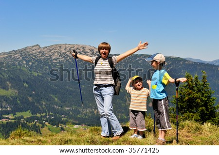 woman wandering with two boys (her children) high in the mountains