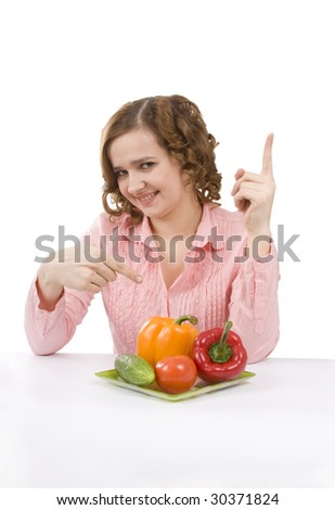 Woman wants to eat fresh vegetables. Housewife is holding the plate with pepper, tomato, cucumber. Pretty girl with pepper, tomato, cucumber. Isolated over white background. - stock photo