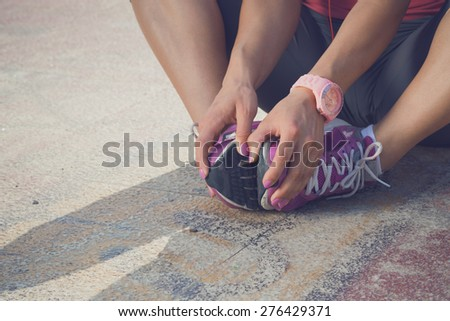 Woman Warming Up Before Running - stock photo