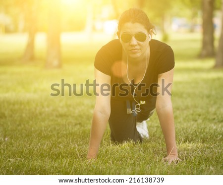 Woman warming up before sport - stock photo