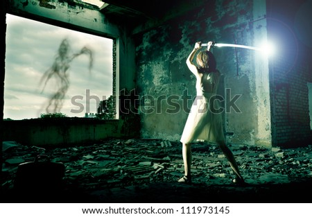 Woman warrior is fighting with ghost - stock photo